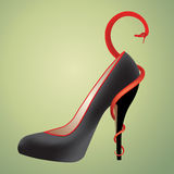 High-heeled shoe. Means fashion, but it maybe hurt Stock Photography