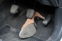 High-heeled shoe stuck under brake Stock Photos