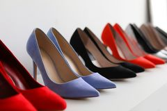 High heeled shoes on shelf. In store stock images