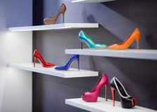 High-heeled shoes. Shoes in the storefront. Fashionable shoes on the shelf of the Italian store stock image