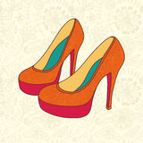 High-heeled vintage shoes with flowers fabric. High heels backgr Royalty Free Stock Photos