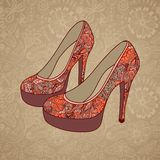 A high-heeled vintage shoes with flowers fabric. High heels background with place for you text on paper background. Royalty Free Stock Images