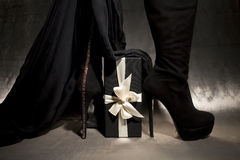 High heelled black shoes. With shiny elements, and gift box with rebon Stock Images