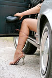 High Heels. Female driver wearing high heel shoes Stock Image