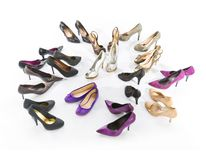 High heels. The picture shows a lot of different high heels standing around Royalty Free Stock Photography