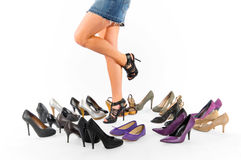 High heels. The picture shows female legs and a lot of different high heels Royalty Free Stock Photo