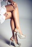 High heels. Elegant female legs in high heels, studio shot Stock Photos