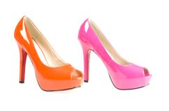 High heels. Pink and orange high heels. Studio shot on a white background Stock Photos