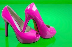 High heels. High heels on green reflective background. Studio shot Royalty Free Stock Images
