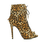 High heels ankle boots in animal print design Royalty Free Stock Photography