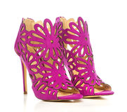 High Heels ankle boots in pink cut-out ornate design Royalty Free Stock Image