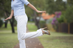 High Heels balancing woman outdoor Stock Photo