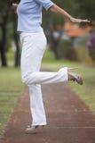 High Heels balancing woman park outdoor Royalty Free Stock Photo