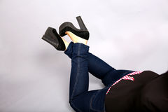 High heels and blue jeans Stock Photography