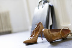 High Heels And Briefcase On Floor Stock Image