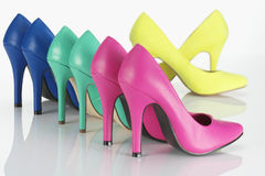 High Heels. Bright coloured high heels on white background stock photos