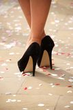 High heels crossed at ankles with confetti Stock Photo