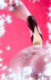 High heels and disco ball Stock Photo