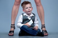 High heels family concept. Stylish baby boy standing with his fa Stock Images