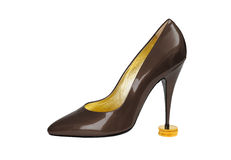 High heels on gold coins. Brown shoe Royalty Free Stock Images