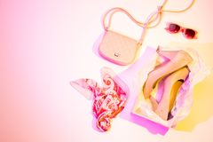 High heels, handbag and scarf - fashion accessories. High heels, handbag, scarf and sunglasses - women`s spring fashion accessories. Colorful multicolor tonal Royalty Free Stock Photo