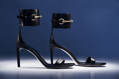 High heels. Image is posed on dark background Royalty Free Stock Photos