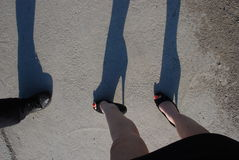 The high heels and mini skirt on the street, talking of women and men, dea Stock Photography