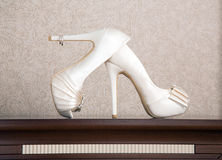 High heels. Over a wood table Stock Photography