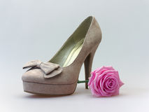 High heels with pink rose. Beautiful soft surface high heel with pink rose Royalty Free Stock Photography