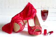 High heels and red g-string abstract concept Stock Images