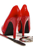 High heels and riding crop Royalty Free Stock Image