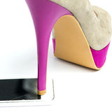 High heels shoe stepping on glass of iphone Royalty Free Stock Image