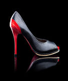 High Heels Shoes. Black and red female high heels shoes on a black background - Side View Stock Photos