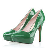 High Heels shoes with platform sole, green patent leather. Pair of High Heels shoes with platform sole, green patent leather, isolated on white Stock Photos