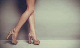 High heels shoes on female legs. Female fashion. Closeup summer high heels fashionable shoes on female legs royalty free stock photo