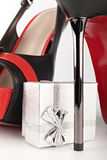 High heels and silver gift box. Black high heels and silver gift box on white Stock Image