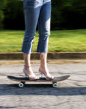High heels on skateboard. Woman with high heels on a skateboard stock photography