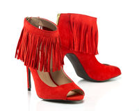 High Heels stiletto with peep toe and fringe details stock images