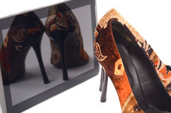High heels and tablet. Stock Photography