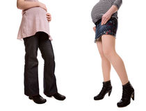 High heels vs flat shoes when pregnant Stock Image