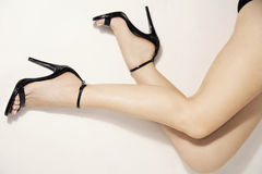 High heels. Woman legs in stylish black heels, studio white stock image