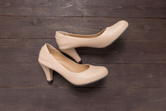 High heels are on wooden background with copy space Royalty Free Stock Images
