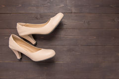High heels are on wooden background with copy space Stock Image