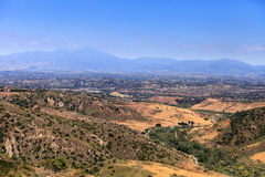 High hillside view in Aliso and Wood Canyons Wilderness Park in. Laguna Beach with Saddleback mountains in the background in Summer Royalty Free Stock Photo