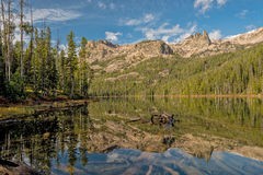 High Idaho mountain lake reflection with clouds Stock Photography