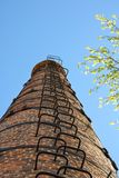 High industrial chimney view from below. Against the background of the sky.  stock images