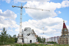 High industrial crane at construction site of church Royalty Free Stock Images