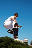 High jump. Skateboarder on a high jump Royalty Free Stock Image