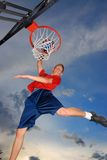 High Jump. Teen jump high and pot ball in basket Stock Photos