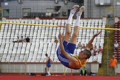 High jump athlete. Male athlete performing during high jump discipline at Romanian International Atheltics Championship, Stefan cel Mare Stadium, Bucharest Royalty Free Stock Photography